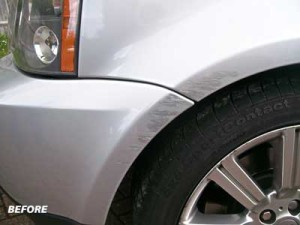 Paint scuff on wheel arch of Range Rover